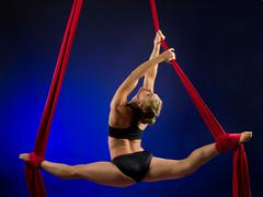 Woman performing acrobatics - stock photo