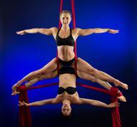 Women performing acrobatics - stock photo
