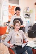 Beautiful lady in hairdressing saloon - stock photo