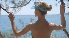 Beautiful girl looking on sea, tourist on vacation6 perfect view, slim model Stock Footage