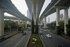 High angle view of traffic under flyover, Shanghai, China Kuvituskuvat