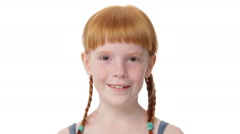 Close up little ginger girl is coquettishly  smiling Stock Footage