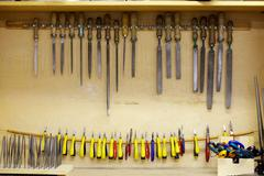 Carpentry tools stored in handmade cupboard Stock Photos