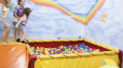 children playing in the ball pool - stock footage