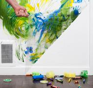 Helpful Ideas for Busy Dads: the Peel-A-Wall crafts cleanup system Stock Photos