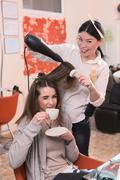 Beautiful lady in hairdressing saloon Stock Photos