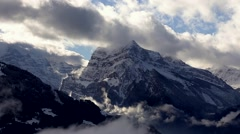 4k time lapse of clouds mass rolling over Tibet snow-Covered mountains,Danggula - stock footage