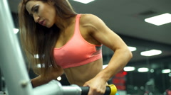 close up strong female works out on training apparatus slow motion - stock footage