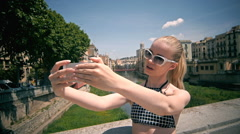 Beautiful young model smiling and making selfie in historical center Stock Footage