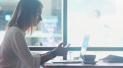 Freelancer texting in mobile phone in cafe Stock Footage