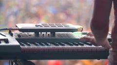 Man with synthesizer plays music on the concert Stock Footage