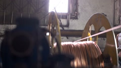 Woman coil conductor copper cable factory - stock footage