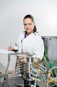 Portrait of female scientist, doing research on a innovative technology for Kuvituskuvat