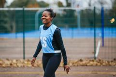 Young female netball player on netball court - stock photo