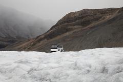 Snowmobile on glacier, Canada - stock photo