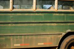 Dusty green bus, side view - stock photo