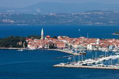 Aerial view of harbor in coastal city - stock photo