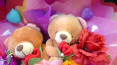 Beautiful  flowers bunch with funny toys Stock Footage