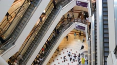 Escalator 4k shopping mall crowd of people buy shop center centre sales shops Stock Footage