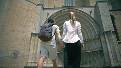 Young tourist couple near catholic church in girona. Love vacation concept Stock Footage