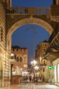Stone archway over city street Stock Photos