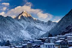 Mountain overlooking snowy village Stock Photos