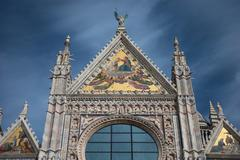 Ornate carvings on Siena Cathedral - stock photo