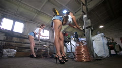 Heavy women work in the cable factory Stock Footage