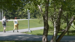 Senior couple nordic walking in the park - stock footage
