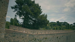 Girl take photo on the fortress wall. Girona city View from the top Stock Footage