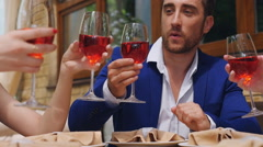 Celebration. friends clinking glasses of wine at restaurant - stock footage
