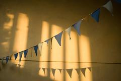Bunting against yellow wall Stock Photos