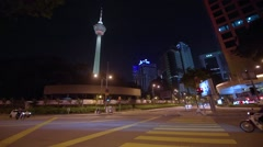KL Menara landmark tower against dusk sky Stock Footage