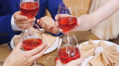 Good friends for dinner or lunch in a fine restaurant, clinking glasses - stock footage