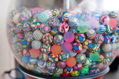 Colorful balls in vending machine - stock photo