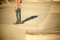 Skateboarder in skate park Stock Photos