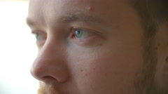 Close up of part of a blue-eyed man's face as he blinks Stock Footage