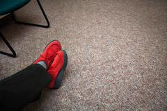 Red shoes in waiting room - stock photo