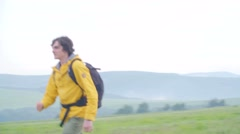 Driver Picking up Hitchhiker in Countryside - stock footage