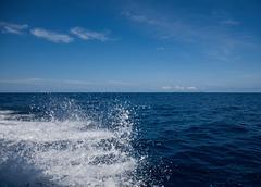 Sea spray from speedboat on South China Sea near Tioman Island, Malaysia - stock photo