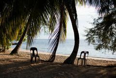 Chairs on a tropical beach, Tioman Island, Malaysia - stock photo