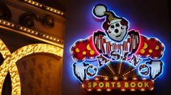 Clown Casino Sports Book Neon Sign - Las Vegas - stock footage