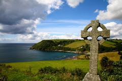 Old cross in coastal landscape - stock photo