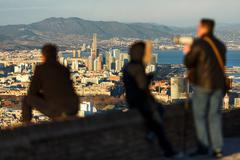 Tourists looking at view, Barcelona, Catalonia, Spain Stock Photos