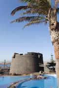 Fortified tower and pool, Caleta de Fuste beach, Antigua, Fuerteventura, Canary Stock Photos