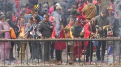 Pilgrims ligthing candles and inscence sticks,Dakshinkali,Nepal Stock Footage