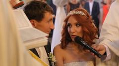 Close up wedding couple in a church with candles Stock Footage