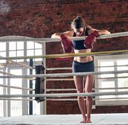 Woman training gym boxing mma ring shadow boxing mixed martial arts fitness Stock Photos