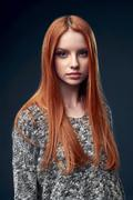 Beautiful red haired female in grey sweater Stock Photos