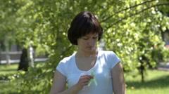 Woman pinning lime green awareness ribbon Stock Footage
